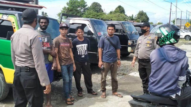 Bhabinkamtibmas Polres Mimika Beri Imbauan Pemberlakuan New Normal.