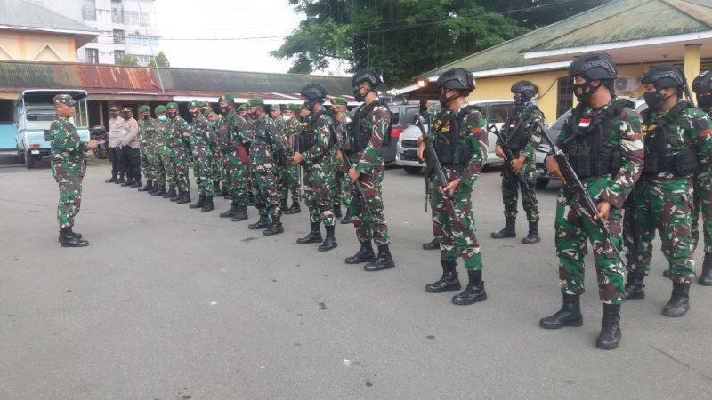 Kodim 1710/Mimika Bersama Satuan TNI/Polri Lakukan Pengamanan Malam Pergantian Tahun 2021